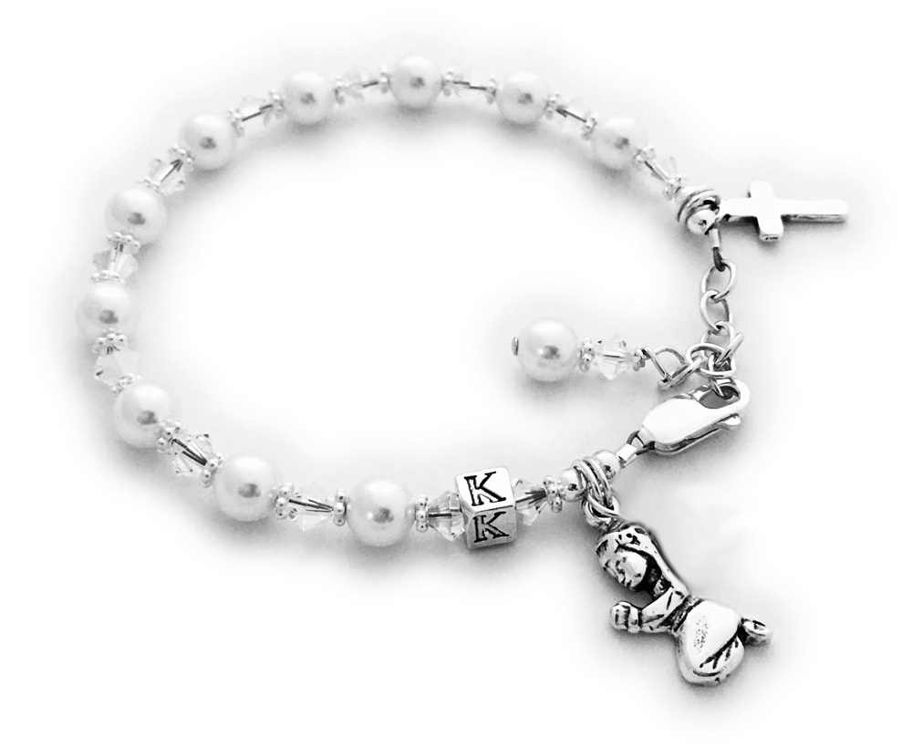 Confirmation or First Communion Bracelet Clear (April birthstone) Swarovski Crystals and Pearls with a Praying Girl and Simple Cross .925 Sterling Silver Charms are on this beautiful bracelet. They picked the initial K during the ordering process. The sterling silver lobster clasp with an extension comes with this bracelet so it will grow with the little girl.