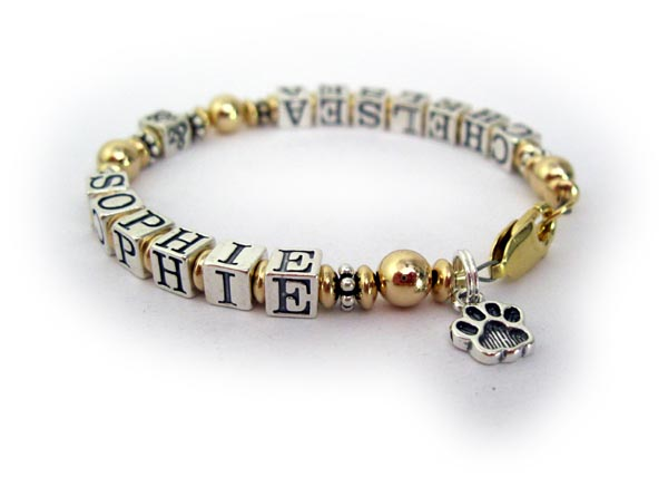 In memory of our pets Chelsea and Sophie. They added a Paw Print Charm.
