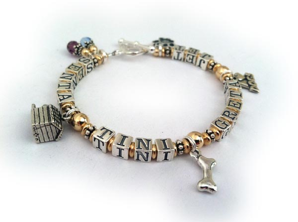 4 pets names on this bracelet with 4 dog charms and birthstone crystal dangles