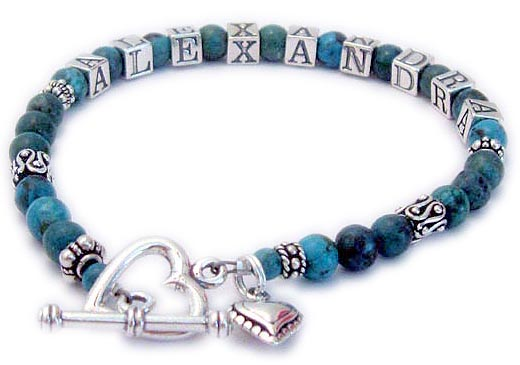 JBL-Gem8Turq	1-String Bracelet Shown with an add-on Heart Toggle Clasp and a Beaded Heart Charm. Order: ALEXANDRA/Turq