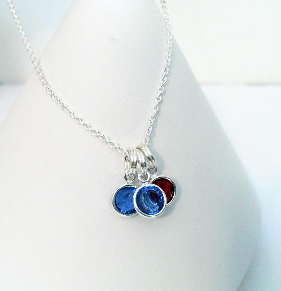 Swarovski Crystal Channel Birthstone Necklace shown with 3 birthstone charms - September, September, July