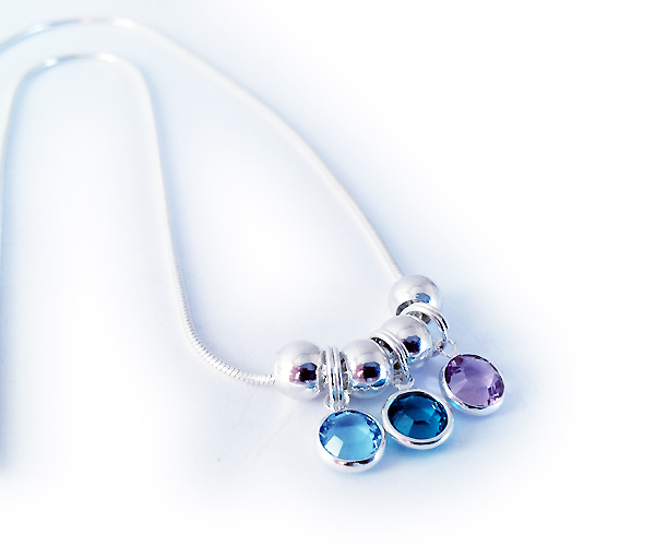Swarovski Crystal Channel Birthstone Necklace shown with 3 birthstone charms - March, December and June