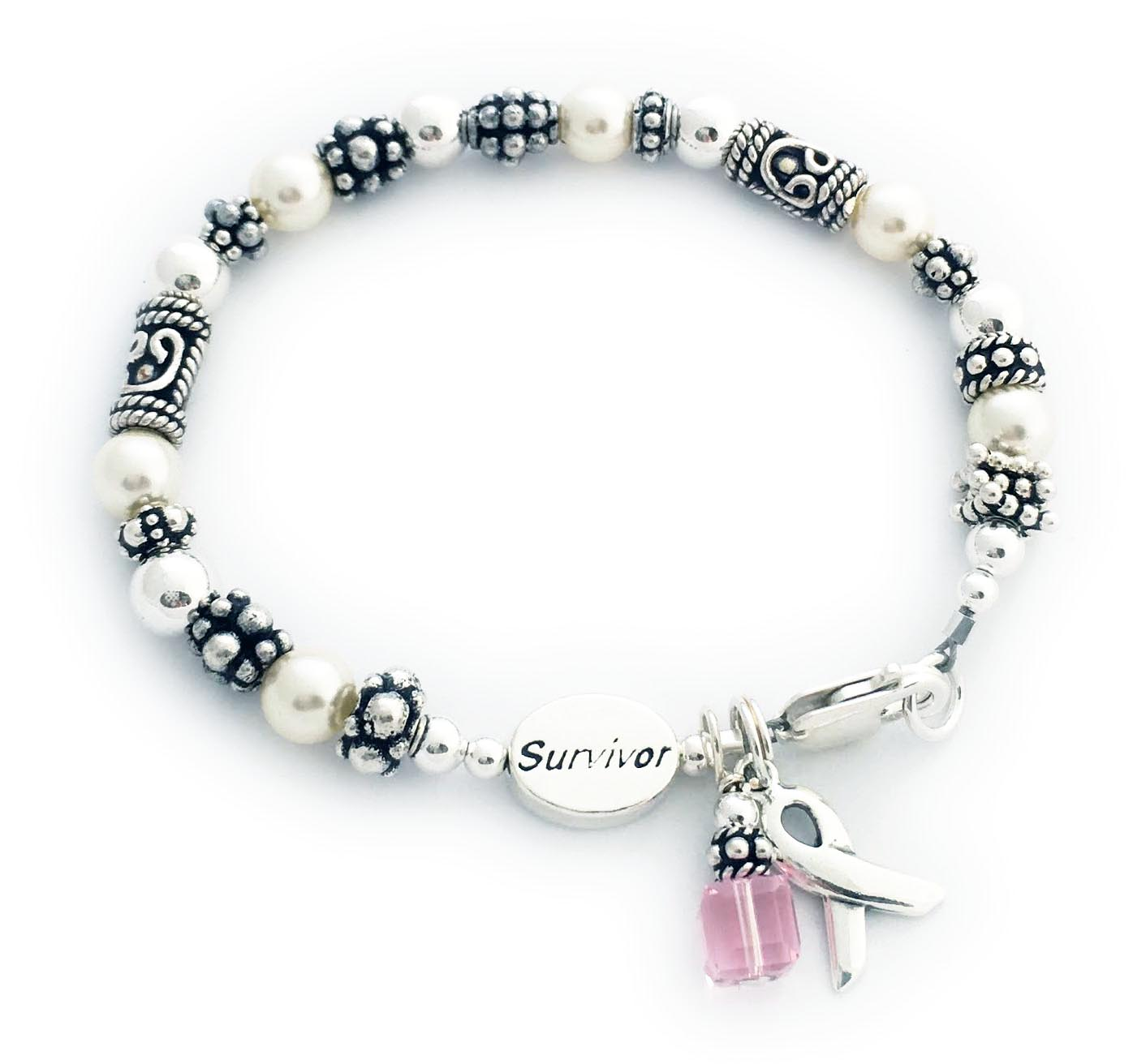 Cancer Survivor Bracelet. Shown with a pink dangle and ribbon charm. You choose the cancer awareness color. You may added SURVIVOR, In memory, Hope or Courage beads. JBL-R-42-sterling