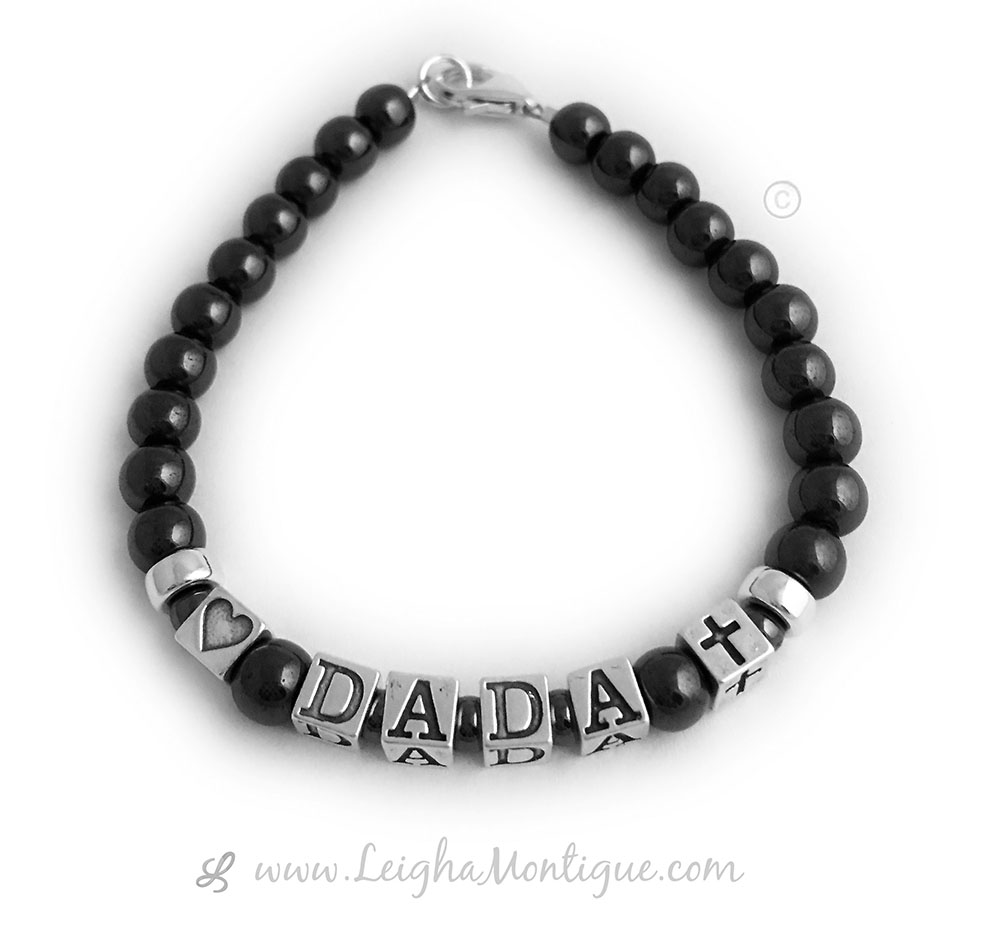 """(heart) DADA (Cross)"" - 6 characters This DADA Magnetic Hematite Bracelet is shown with a Heart bead, DADA and a Cross bead. The black hematite beads are magnetic."