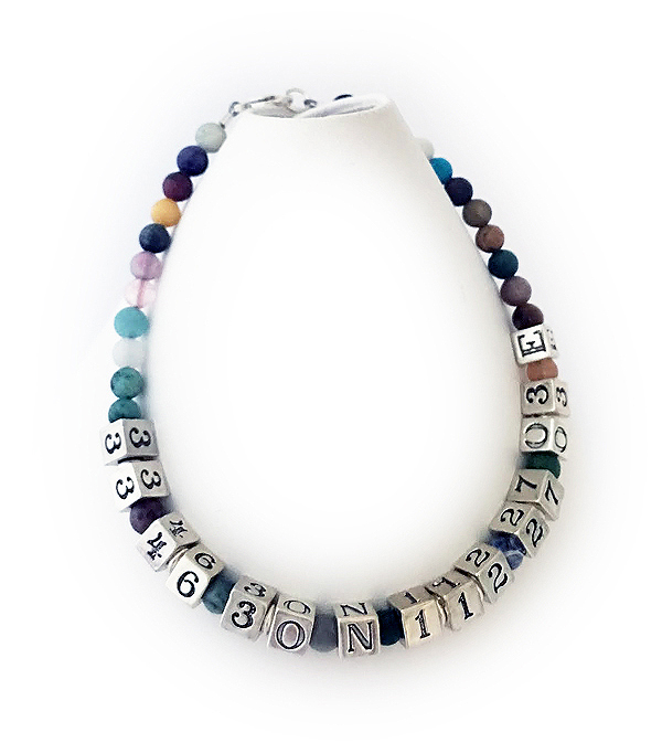 JBL-Gem7-1 string with a lobster claw clasp. This is a 1 string bracelet shown with GPS location coordinates. Shown with 6 extra letters. Up to 9 letters are free, per string.