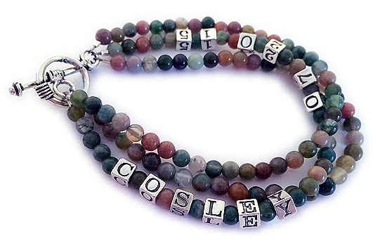 This bracelet is made with 4mm round Fancy Jasper beads and other colorful gemstones. It has 4.5mm block letters and a sterling silver clasp. You choose the number of strings. This bracelet is shown with 3 strings.