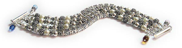 JBL-PS1-4string Matthew, Justin, Alex, Mackenzie  This is a 4-string Pearl Gemstone bracelet with a child's name on each string. They also added 4 birthstone crystal dangles. It is shown on a 4-string slide clasp.
