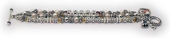 JBL-PS2-3string This bracelet is shown with Gemstones before and after each name. This is a special order (no additional cost). They also added 4 things to their order: Beaded Toggle clasp, a Heart Picture Frame charm, Girl Baby Bootie charm and a Praying Boy charm.