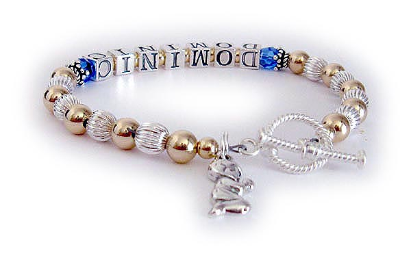 This bracelet is shown with birthstone crystals (free) before and after the name. They added a Praying Boy Charm. Shown with a Twisted Toggle clasp.