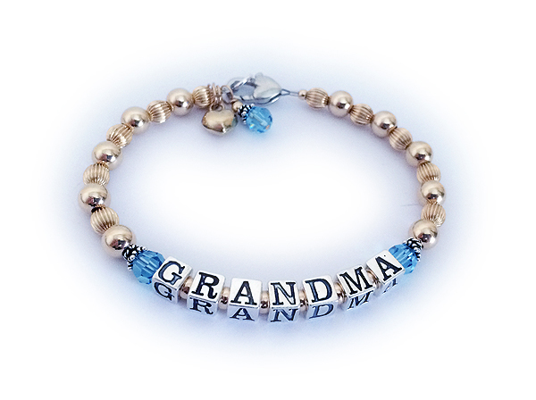 Enter: GRANDMA/Mar They added 3 things to their order: A Heart Lobster Claw Clasp, A 14k GP Puffed Heart Charm and a March Birthstone Crystal Dangle.