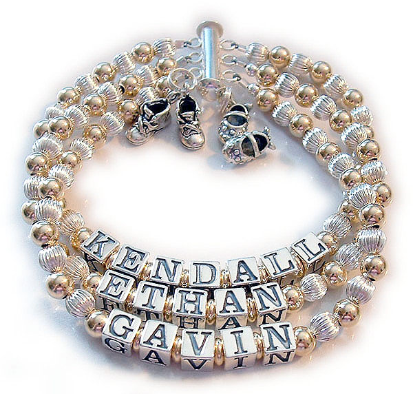 Enter: KENDALL/ETHAN/GAVIN - no crystals This is a 3-string bracelet on a slide clasp. They added 2 charms: Boy Botties and Girl Booties Charms.