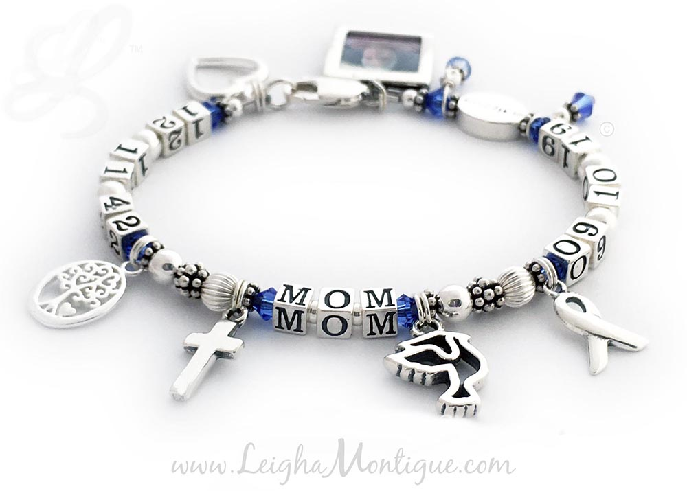 JBL-LifetimeBracelet  This MOM In Memory Bracelet is shown with lots of add-on meaningful charms. They picked September or Dark Blue for Colon Cancer. An In Memory Bead, a Colon Cancer Charm and a Ribbon Charm are included in the price. They added 6 additional charms: Square Picture Frame Charm, Open Heart Charm, Tree of Life Charm, Simple Cross Charm, Dove Charm and a December Birthstone Crystal Dangle Charm.