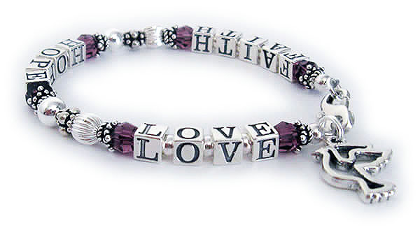 This Faith Hope and Love Bracelet is shown with a lobster claw clasp and they added a PEACE DOVE charm.