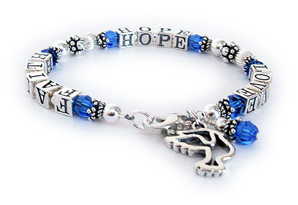This Faith Hope and Love Bracelet is shown with a lobster claw clasp, September Swarovski Crystals and they added a PEACE DOVE charm.