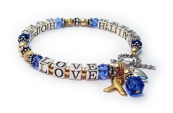 Faith Hope Love Message Bracelet - Shown with 3 add-on charms; Gold Ribbon charm, Birthstone Crystal Danglea and a Small Puffed Heart Charm.
