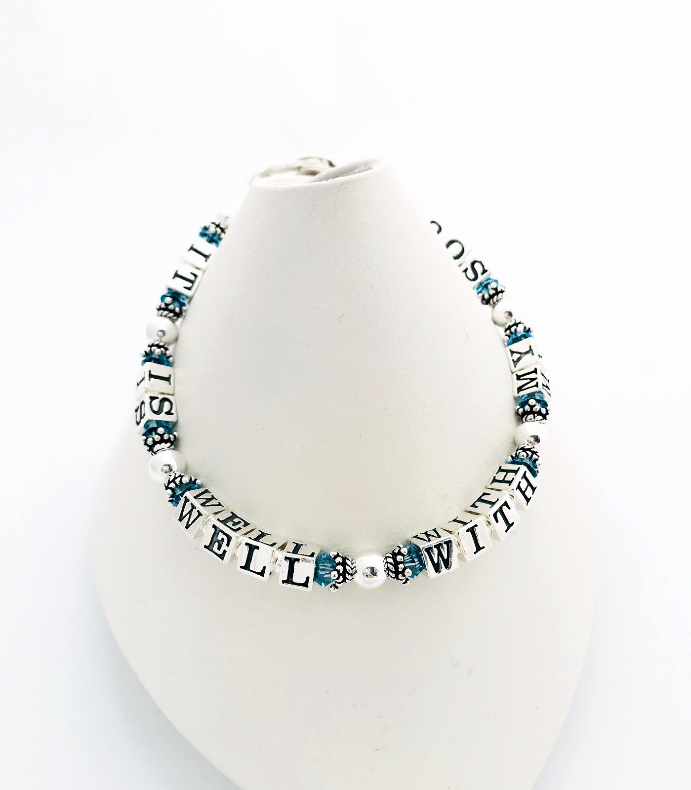It Is Well With My Soul Bracelet shown with a lboster claw clasp and March birthstone crystals. JBL-Mess-IIWWMS