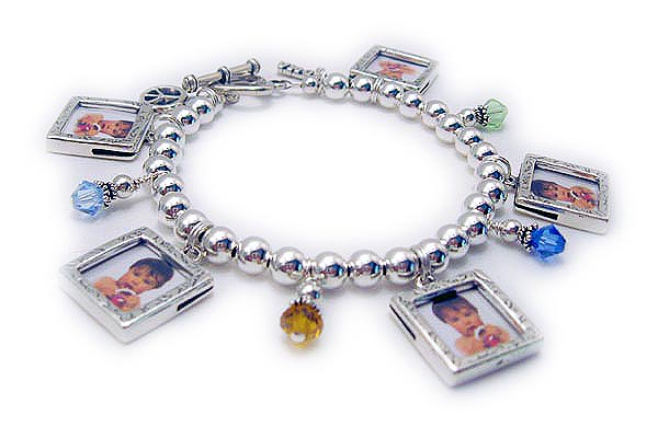 This bracelet comes with 5 sterling silver photo frame charms. They added: Peace Sign, 4 BICONE Birthstone Crystal dangles and a Grandma charm (the Grandma charm is hard to see).