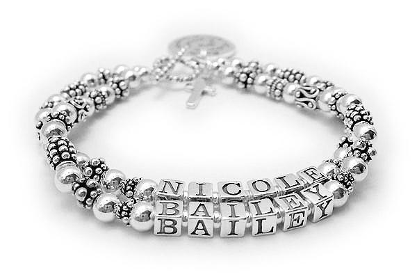 JBL-SS7-2	String Bracelet Nicole/no crystals & Bailey/no crystals. They added a Simple Cross Charm and a Sayings Charm and they picked a simple toggle clasp.