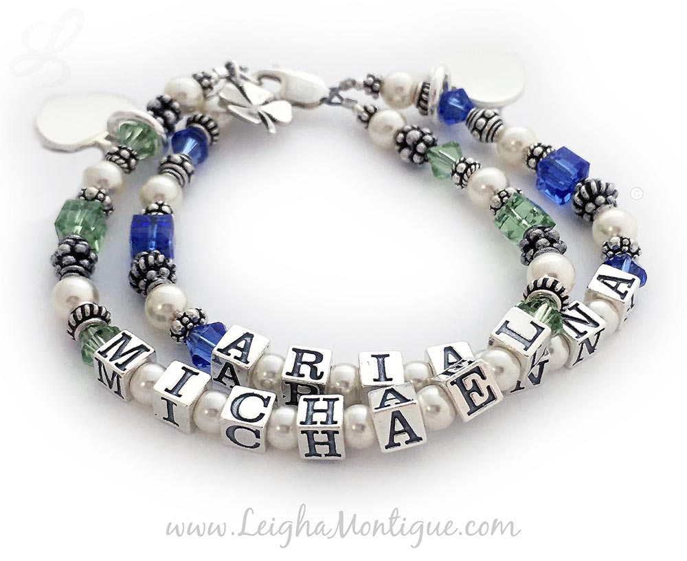 This is a 2-string Birthstone Mother Bracelet with Arianna and September or Sapphire Birthstones and Michael and Peridot or August Birthstones. They also added a Shamrock charm and 2 Initial Charms.