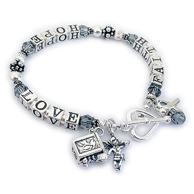 Sterling Silver Faith Hope and Love Bracelet - shown with a Prayer Box Charm, Angle Charm, ribbon Charm and crystal dangle. They added a Heart Toggle clasp
