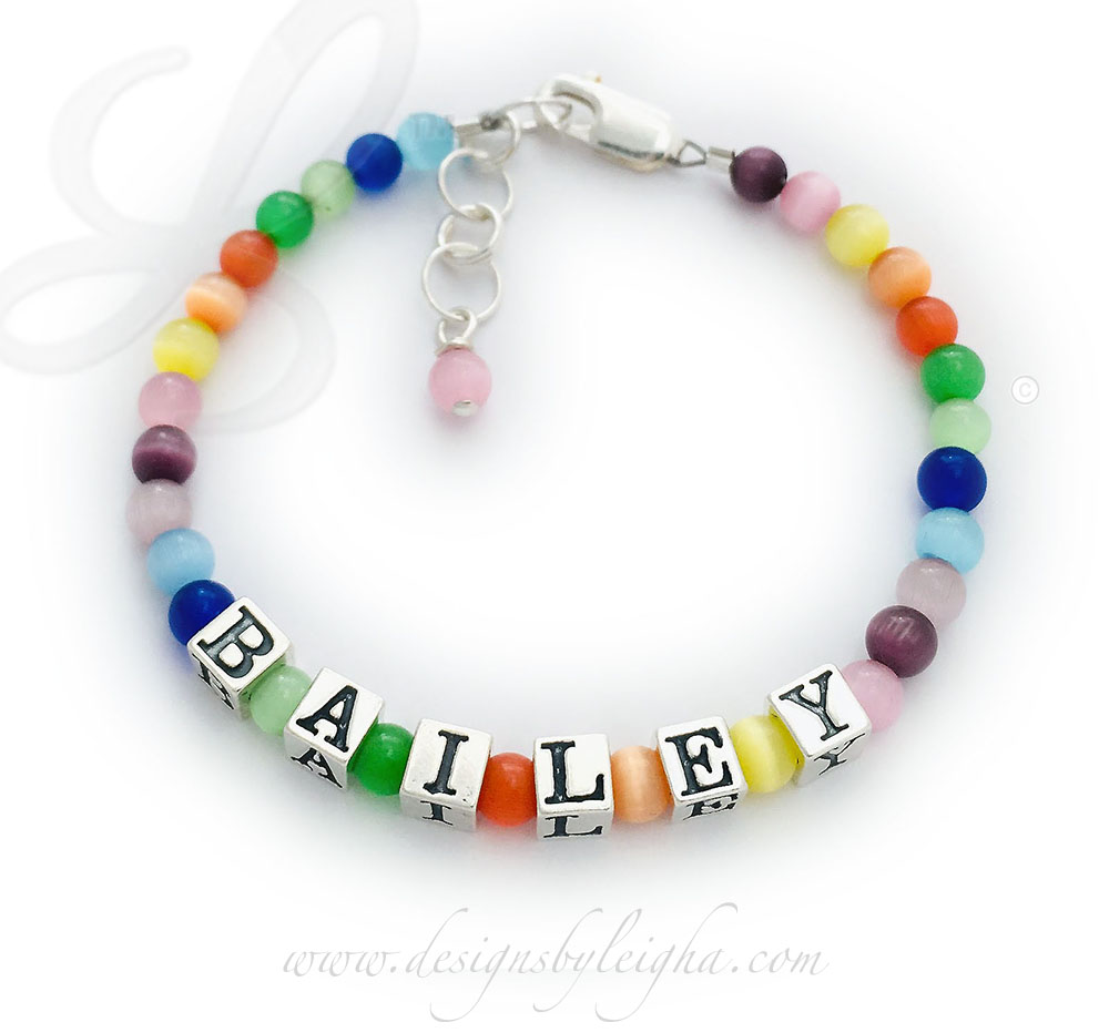 Colorful Cat's Eye Bracelet with BAILEY and an extension clasp.